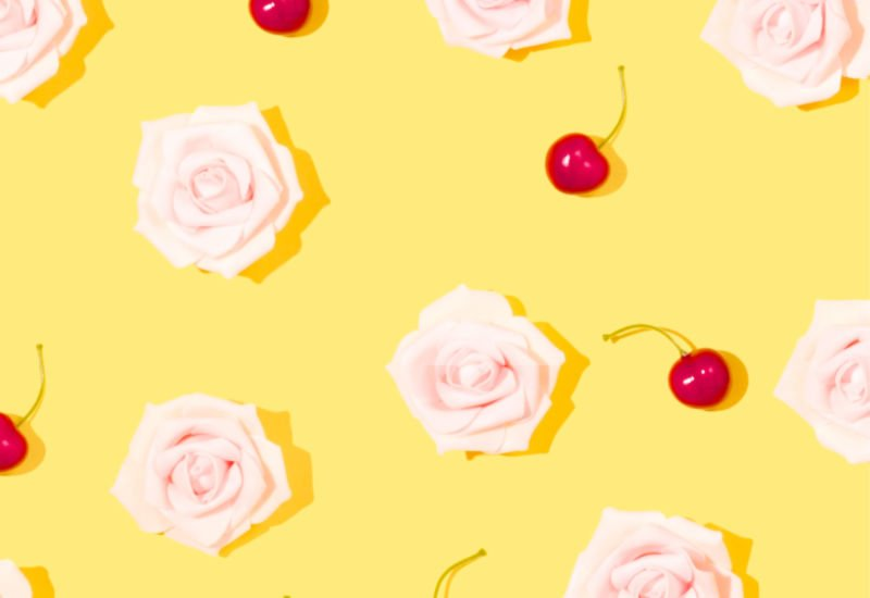 pink roses and cherries on a happy yellow background