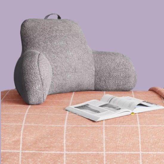 grey sherpa bedrest pillow on blanket
