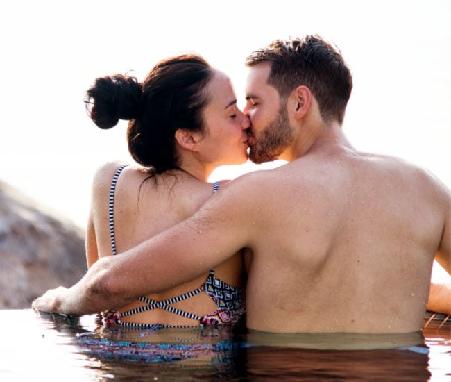 happy couple kissing in a hot spring