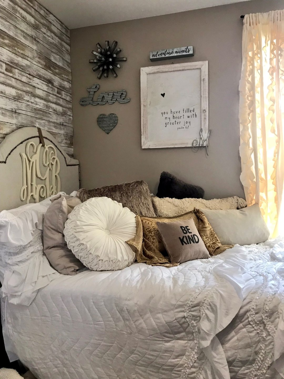 dorm bed after makeover picture with white and neutral bed set and pillows