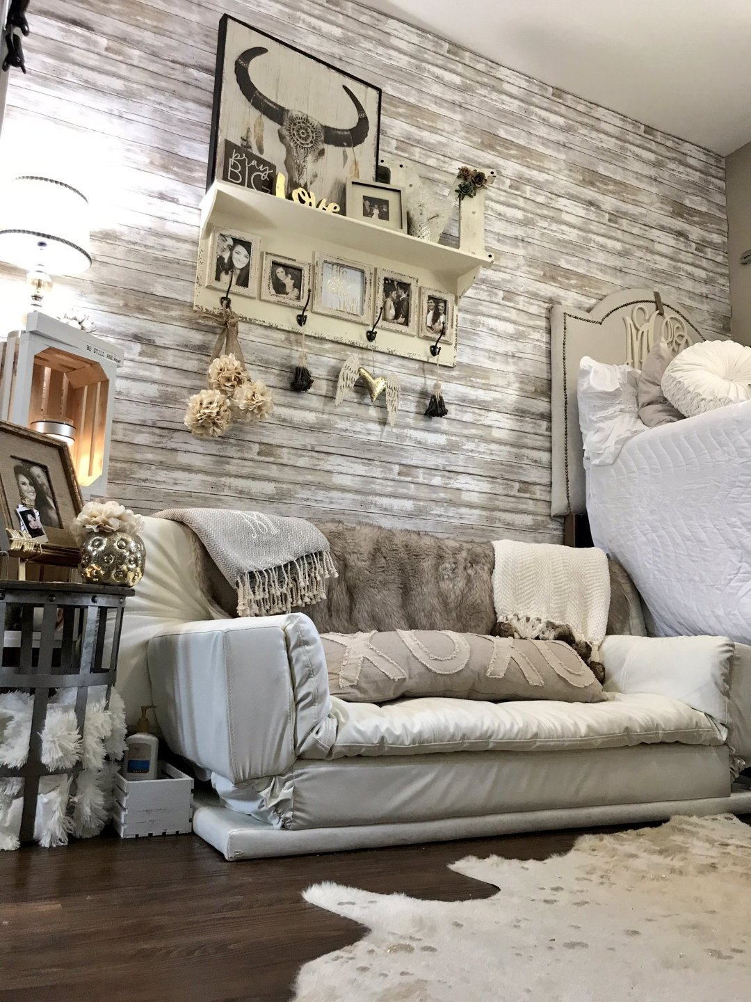 college dorm room decorated with wallpaper, wall decor, and couch in farm style chic