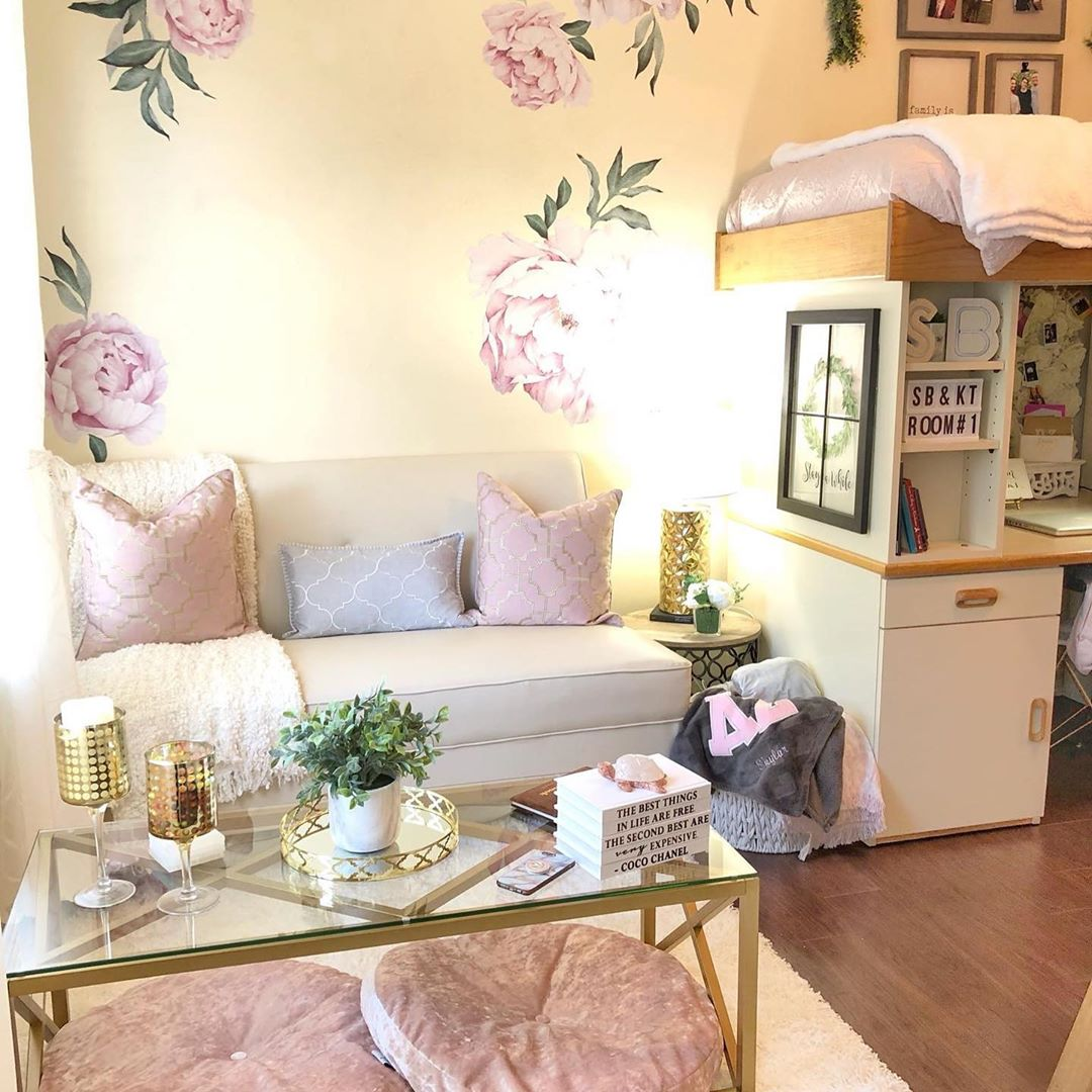 small couch, glass coffee table, peony wallpaper, faux fur rug added to college room