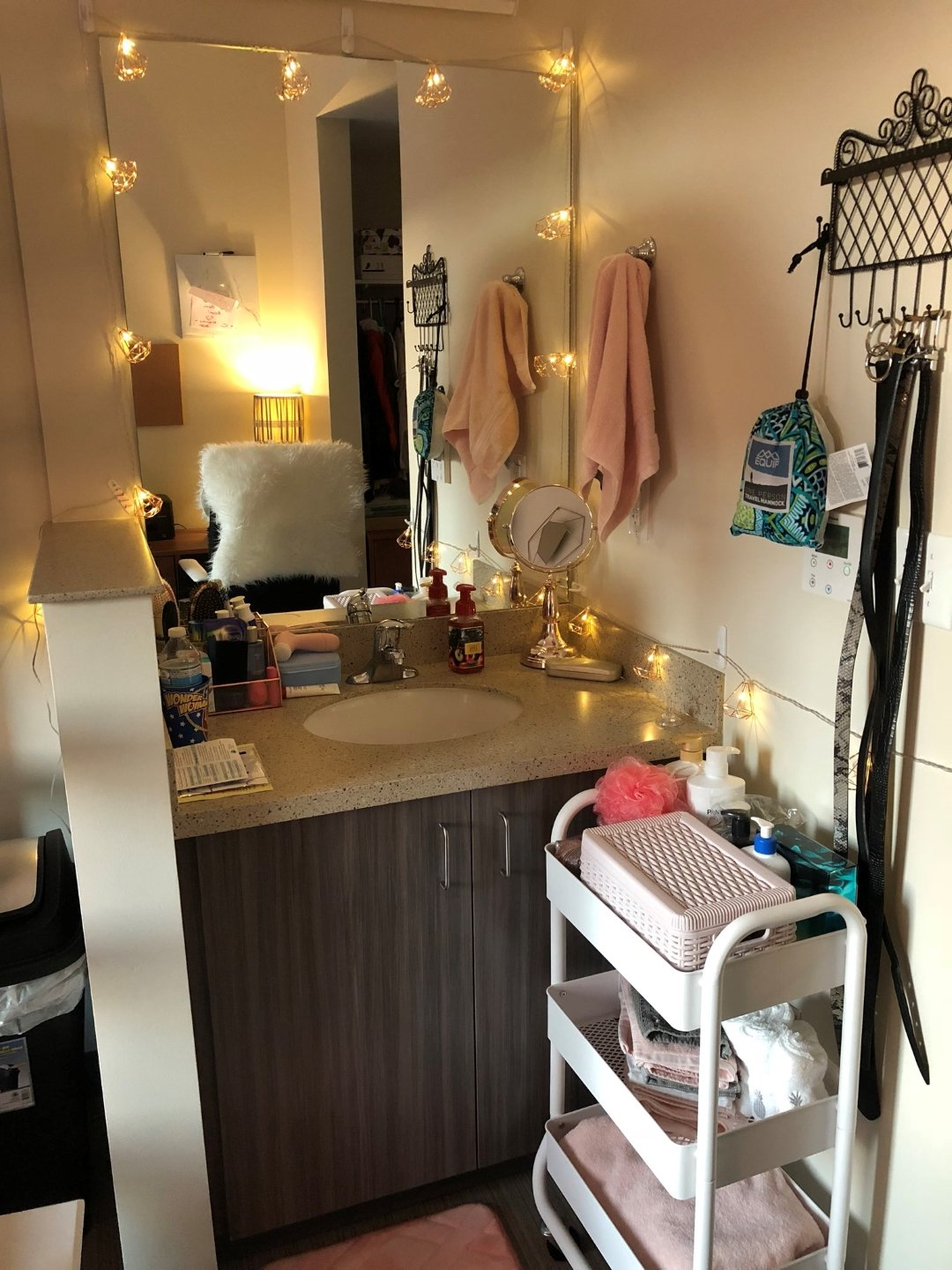 dorm sink area wth fairy lights and 3 tier rolling cart