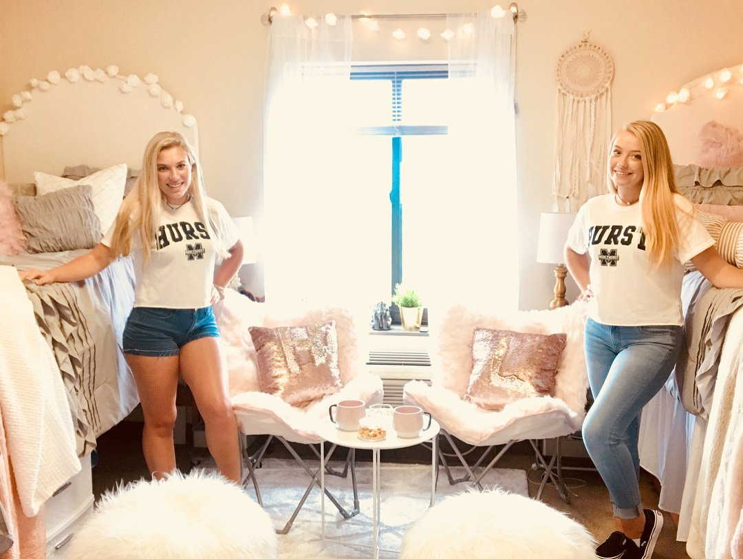 two female college students at Hurst College posing in their cute dorm