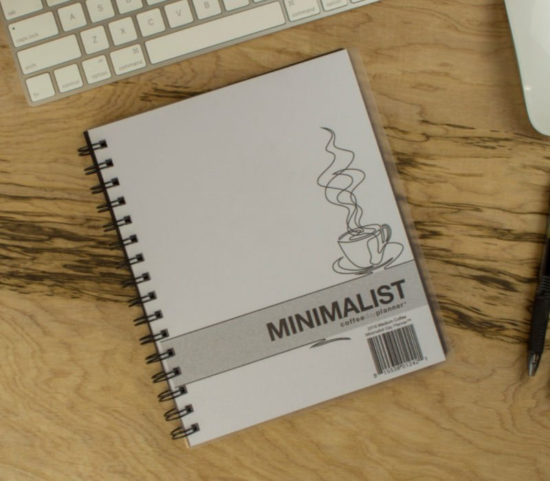 white minimalist planner on desk