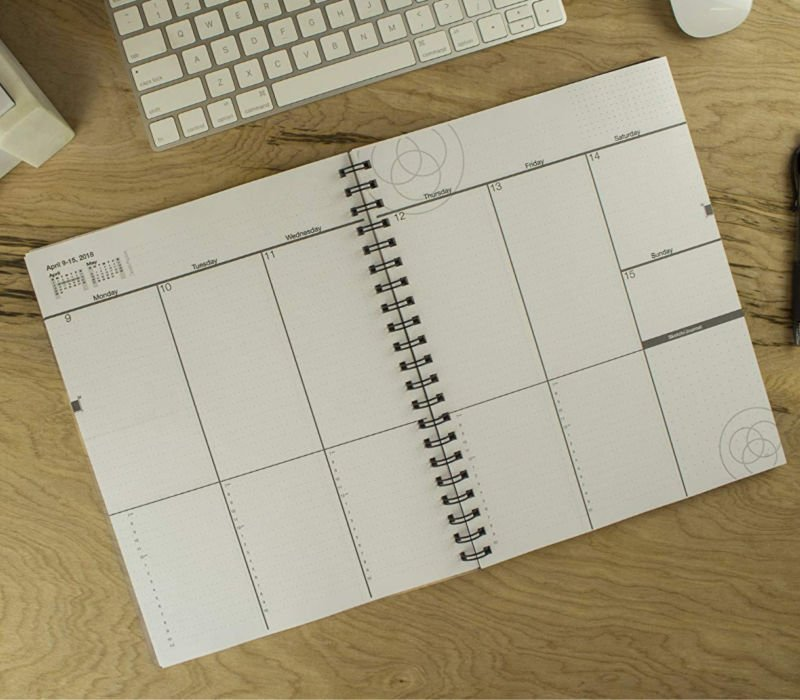 college student planner open on desk