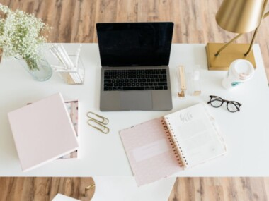 desk with laptop & must haves in college