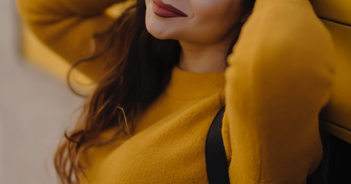 woman in yellow smiling - make money in college