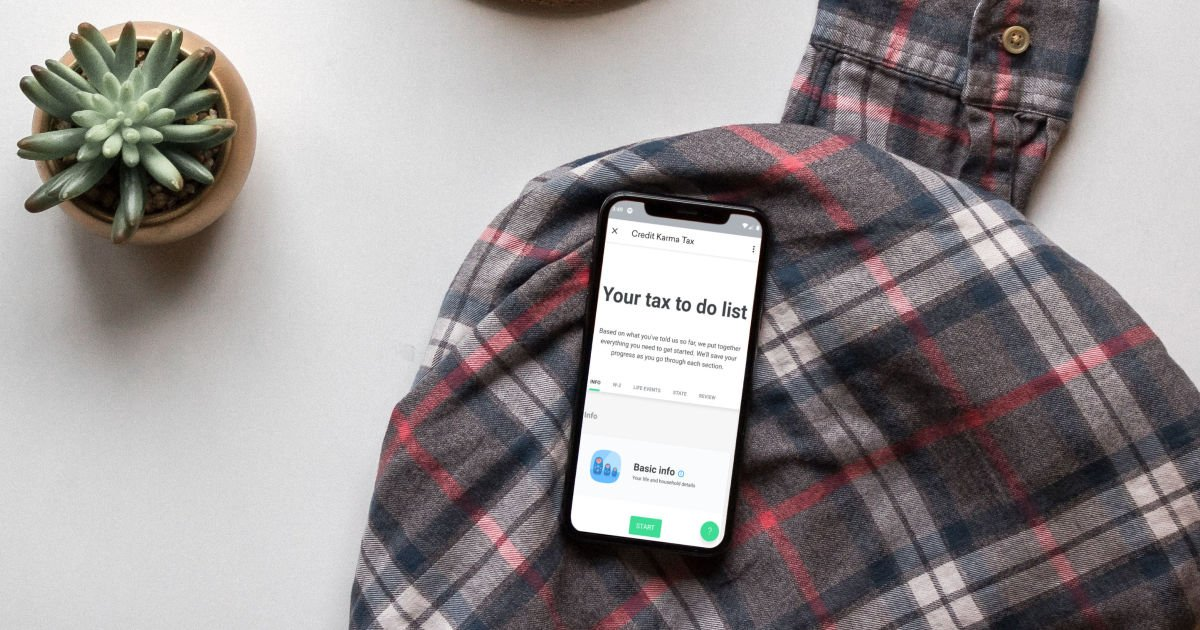 smartphone on a plaid shirt with credit karma tax mobile