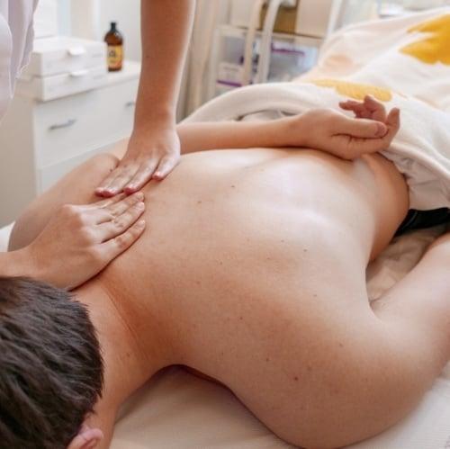 college guy enjoying the gift of massage
