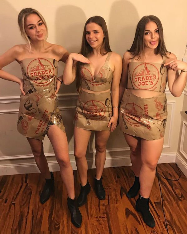 girls dressed in DIY costumes made from Trader Joe's bags