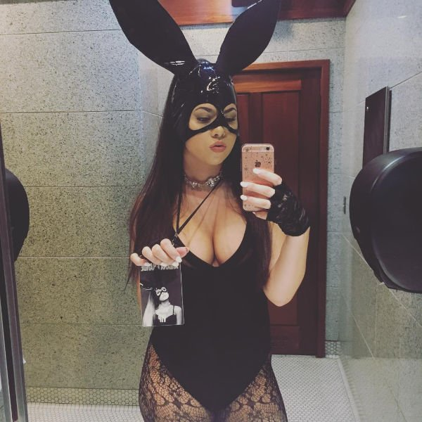 Woman taking selfie in mirror of her Halloween costume