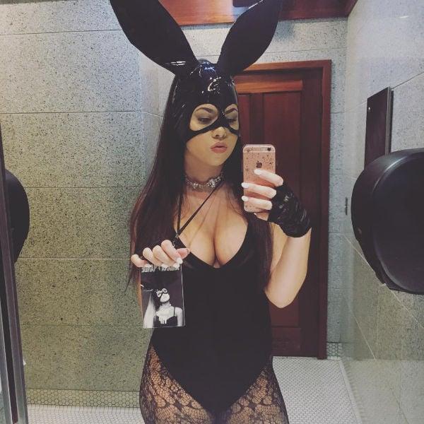 Woman taking selfie in mirror of her Halloween costume
