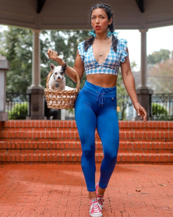 woman in blue yoga pants and plaid crop top