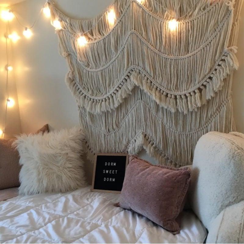 white dorm room theme, letter board, lights, & macrame