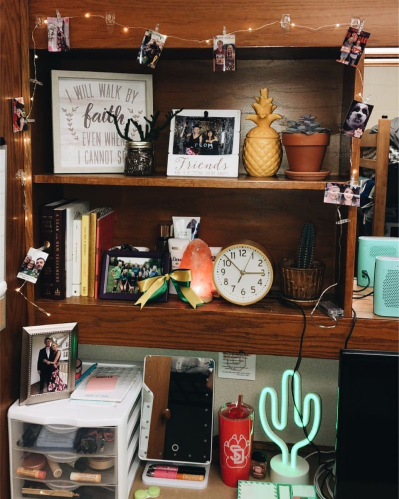 little corner with string lights, neon light, makeup mirror