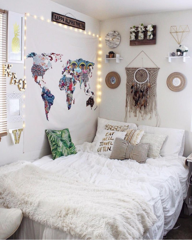 dorm room with white bedding and wall art