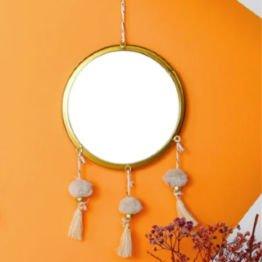round mirror with tassels