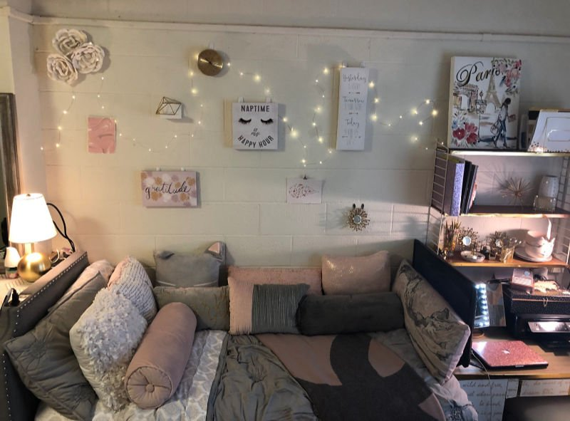 pink and grey room with wall decor