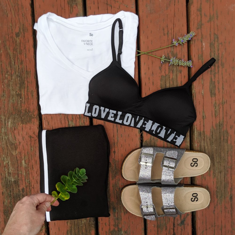 college outfit: white shirt, black bra, two strap sandals
