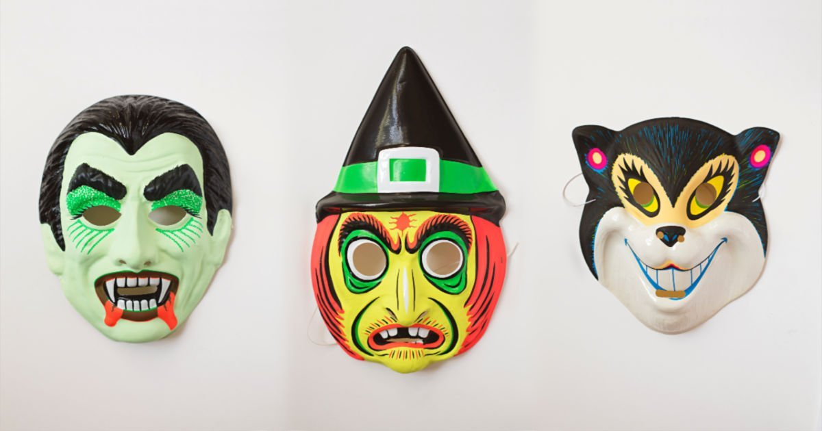three colorful halloween masks: a vampire, a witch and a squirrel