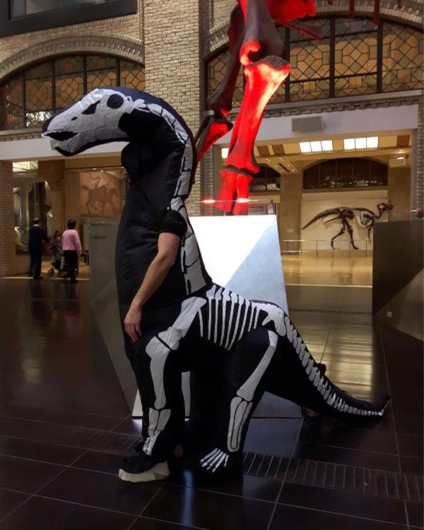 guy in dinosaur Halloween costume