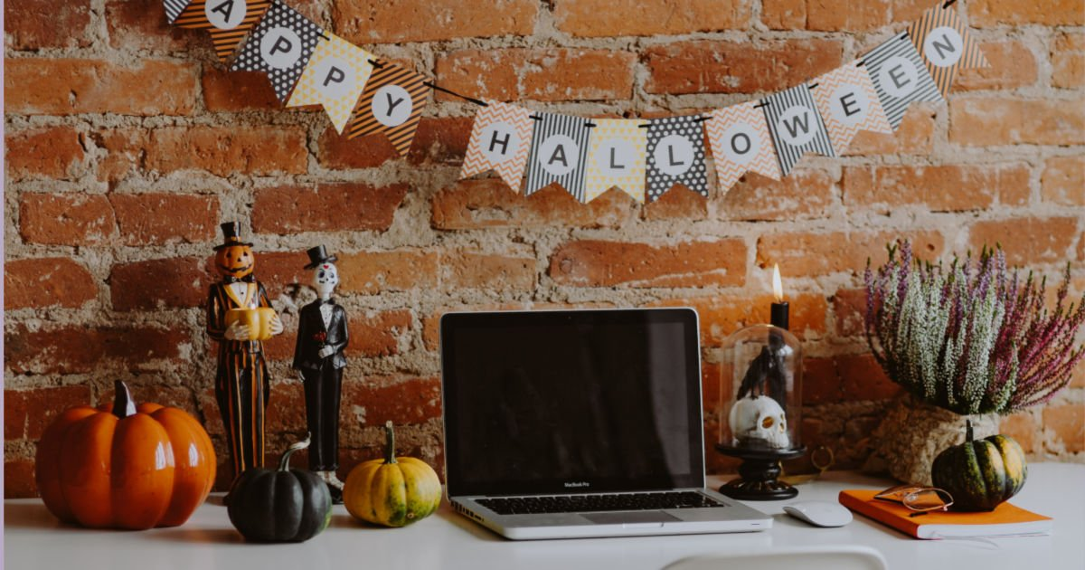 laptop on a desk that's decorated for October
