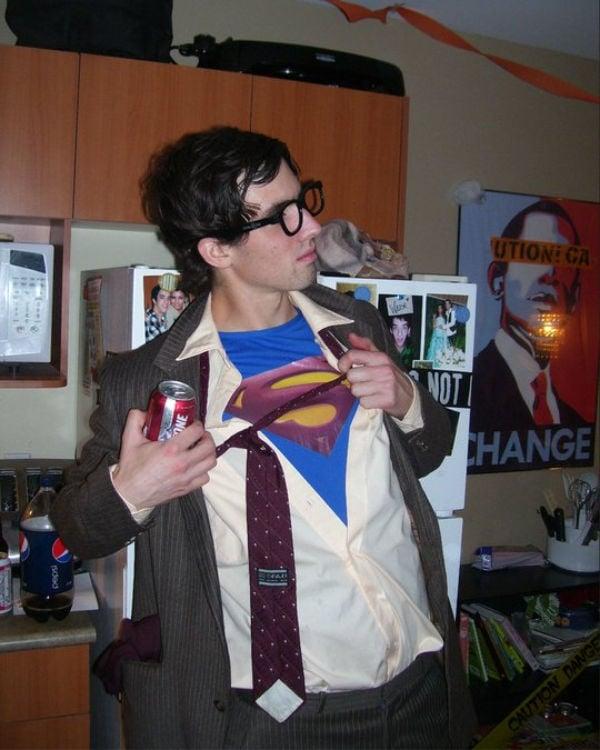 guy showing off super man suit under unbuttoned shirt