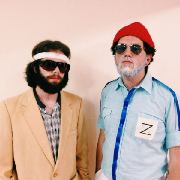 two guys in Wes Anderson character Halloween costumes