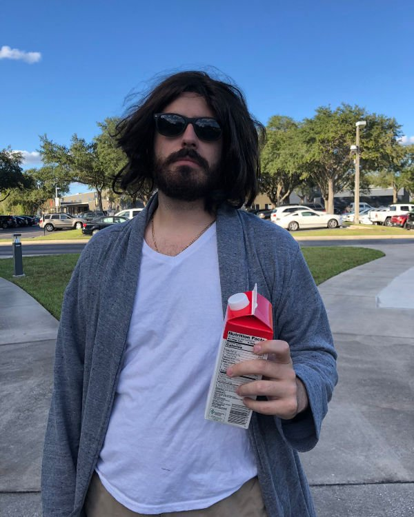 man with shoulder length hair and a beard dressed at the dude for halloween