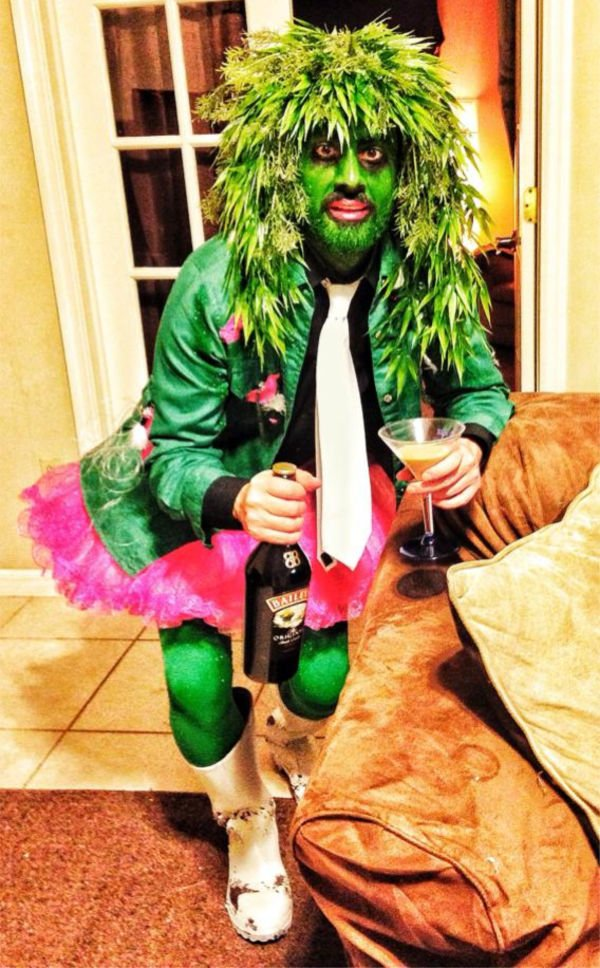 guy wearing a lot of green and a pink tutu
