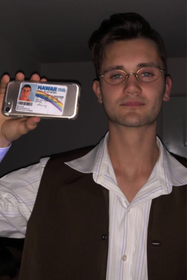 College guy wearing a McLovin costume for Halloween