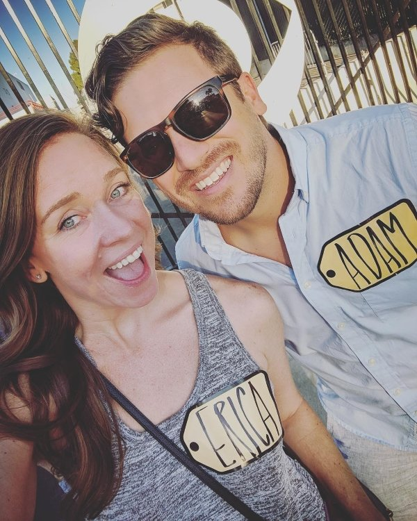 couple wearing last min halloween costumes with price is right stickers