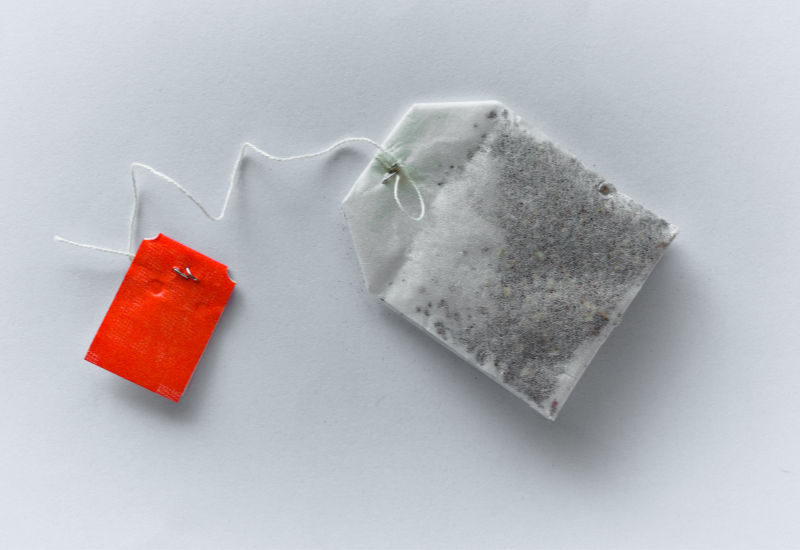 a tea bag with a red tag