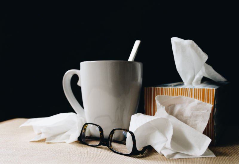 glasses, tissues and a mug sitting together