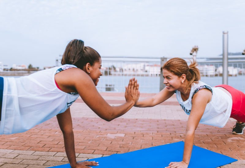 two college woman happy about staying fit together