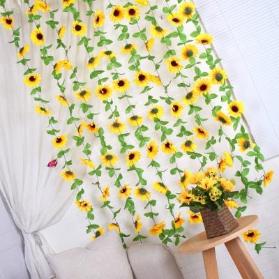 silk sunflower garland hanging on a wall