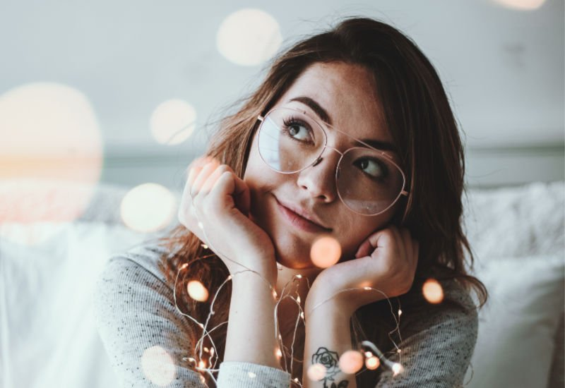 college girl thinking about gifts she wants for Christmas