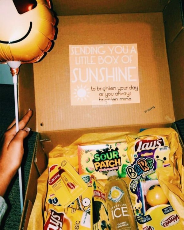 "lots of yellow things in a box with a note that says ""sending you a little box of sunshine"""