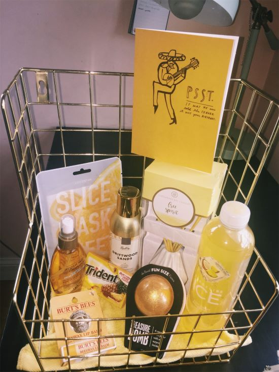 gold wire basket with various yellow self care items