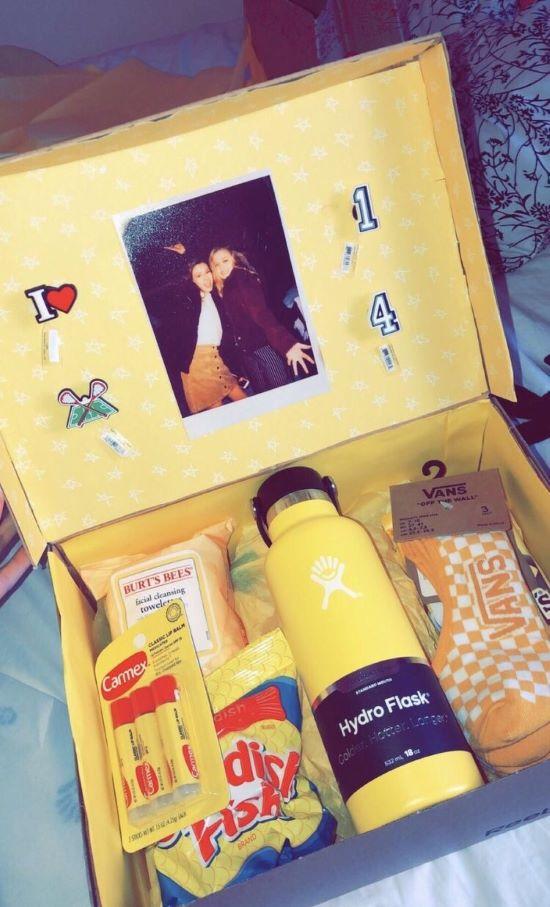 yellow gift box with carmex, vans socks, swedish fish, burt's bees and a hydro flask
