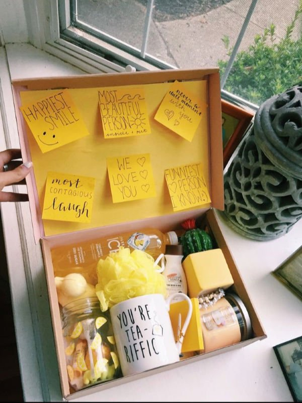 box with a mug that say you're tea-riffic, yellow gifts, and sticky notes with nice messages