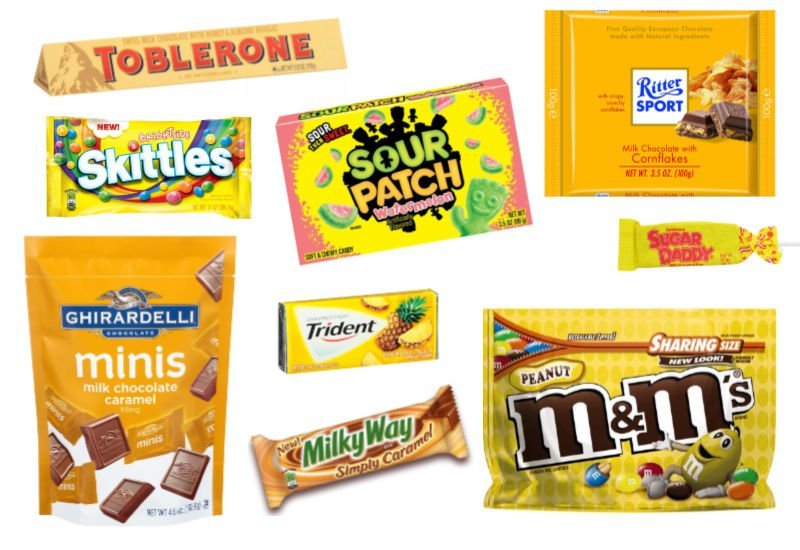 an assortment of candy with yellow packing