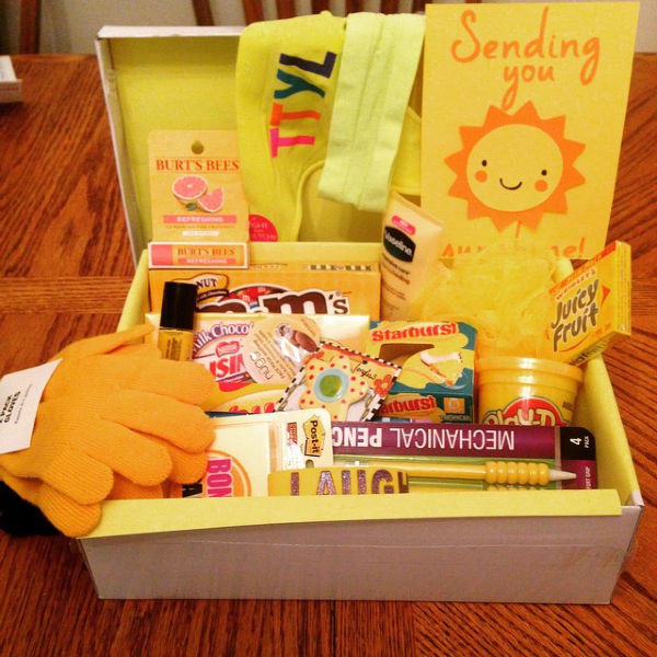 card that says sending you a box of sunshine. box filled with different things that are yellow