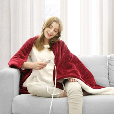 a college age girl using a red wine colored electric blanket to stay warm