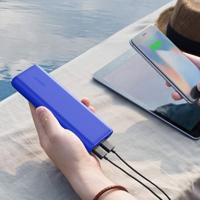 purple power bank charging multiple devices