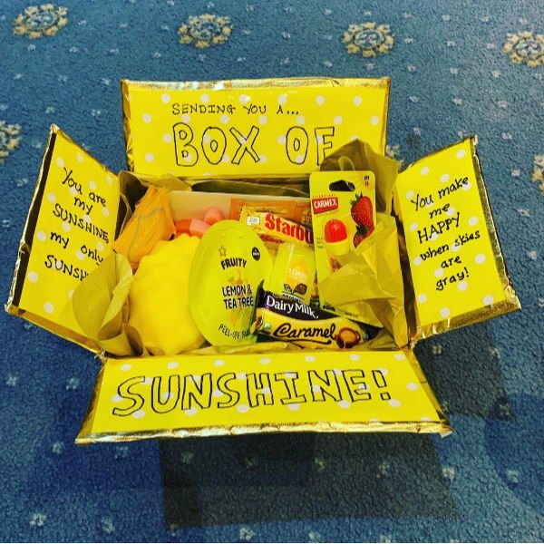 a handmade sunshiney box with yellow goodies to spread happiness