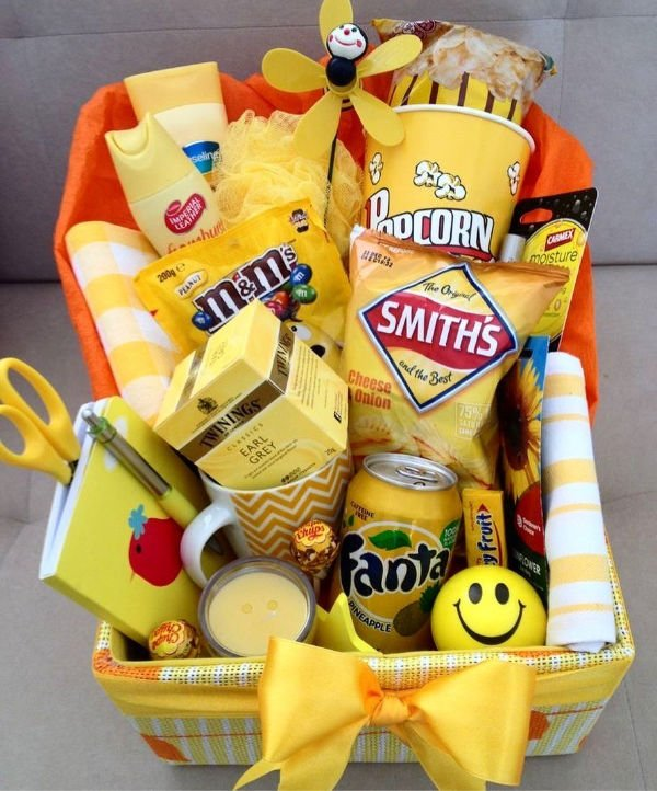 a yellow gift basket stuffed with yellow items and snacks