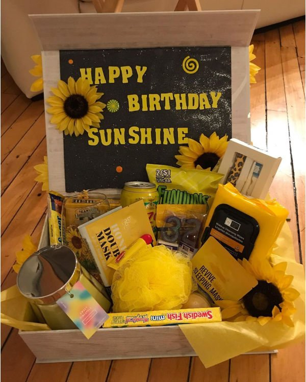 happy birthday sunshine care package with different yellow gifts inside