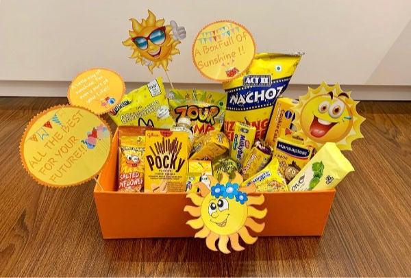 orange box with cartoon suns and goodies